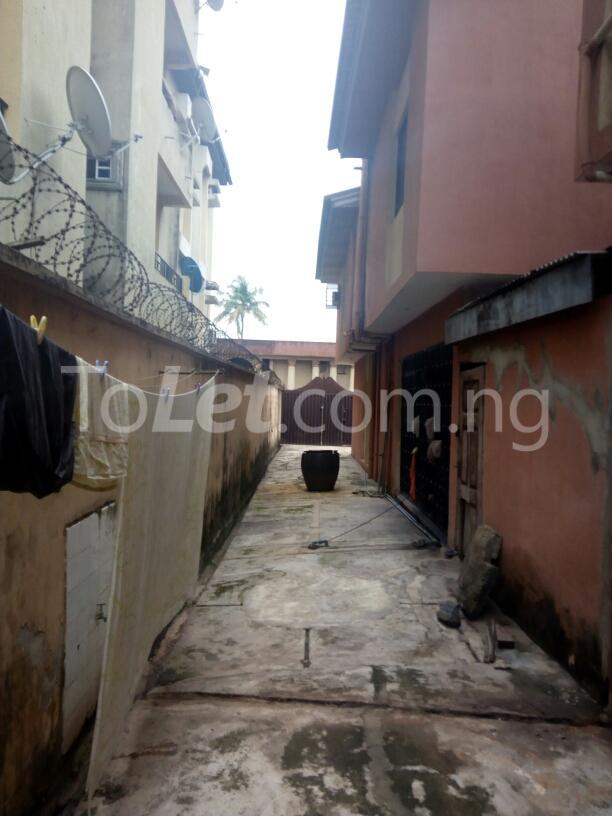 10 bedroom House for sale Adenubi street Ago palace Okota Lagos - 8
