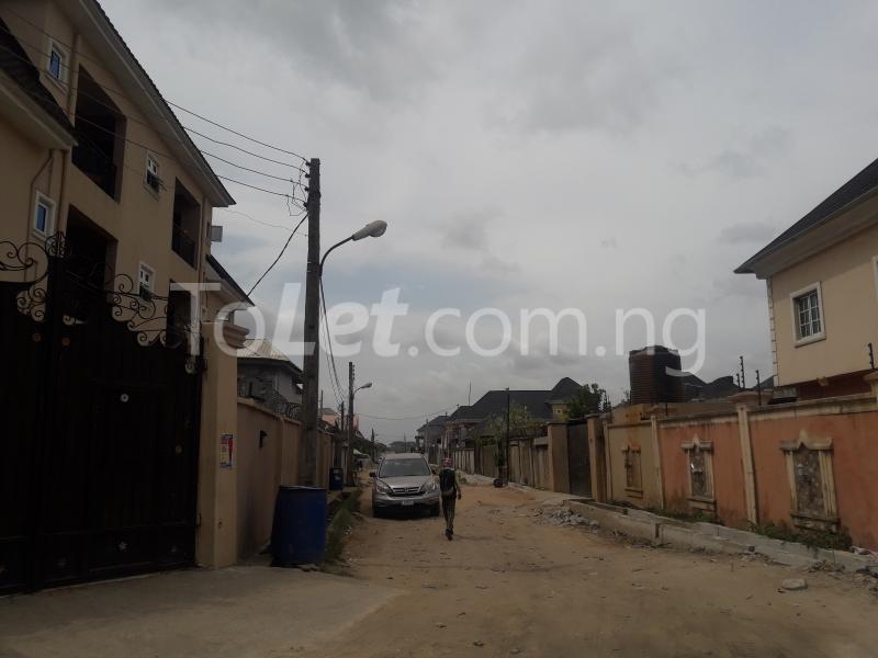 Land for sale VICTORY ESTATE  Ago palace Okota Lagos - 3