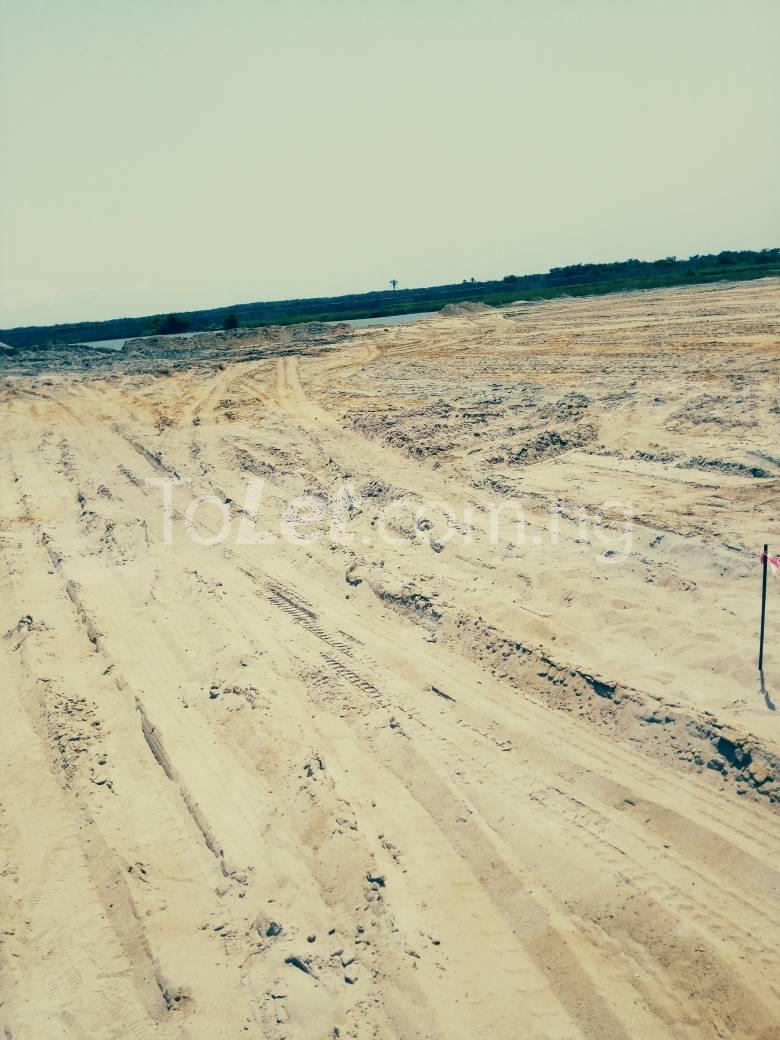 Land for sale Behind Novare Lekki Mall (shoprite) Initial deposit is 640,000 Sangotedo Ajah Lagos - 1