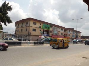 Commercial Property for sale Directly along Ago palace way, Apena and Balogun Bus stop Ago palace Okota Lagos