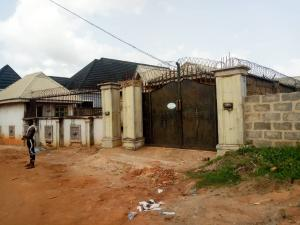 House for sale GRA  Ugbor Benin city. Comprise of 2 units semi detach block of 2 bedroom flat with security house fenced round Oredo Edo