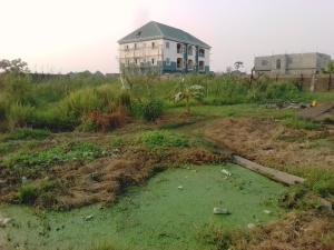 Land for sale Star time estate, Ago palace Okota Lagos