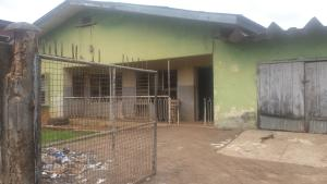 House for sale 4 bedroom bungalow on a 70x100 land size with BQ  Along Iyesigie Street off Oro Street. Easily  accessible from 5 junction is available for sales at #15 milion naira negotiable. this location is at the centre city adjacent O&A Hotel  Egor Edo