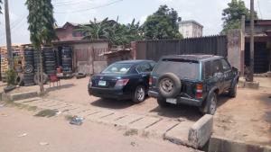 Commercial Land Land for sale Lagos Abeokuta Express way Abule Taylor Bus Stop Ifako Agege Lagos