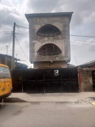 Blocks of Flats House for sale Oluwashina Street off Oduselu Street by Church Busstop  Itire Surulere Lagos