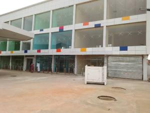 Office Space Commercial Property for rent  academy Bridge immediately before bridge by the right at main academy bus stop ibadan Egbeda Oyo