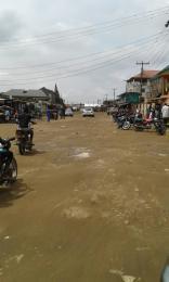 Land for sale last bus stop off ago palace way  Ago palace Okota Lagos