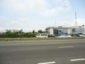 Commercial Land Land for sale Directly along Lekki-Epe expressway, beside Zenith bank Lekki Lagos