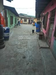 Office Space Commercial Property for sale  Pako Bus Stop.  Dopemu Agege Lagos